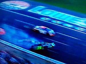 Gordon is struck as he slides back across the track.