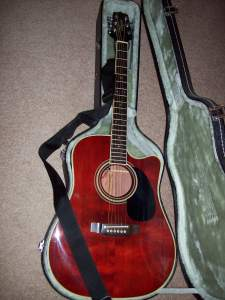 Takamine steel string acoustic w/ pickup.