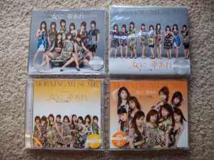"Momusu's ""onna ni sachi are"" type A, B, & regular editions plus PV DVD single."