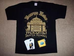 T-shirt (front) w/ set of 7 pics & wristband.